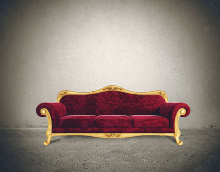 Success concept with comfortable retro sofa in a grunge room photo