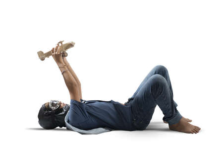 Young boy playing with toy wooden airplane Stock Photo - 24633371