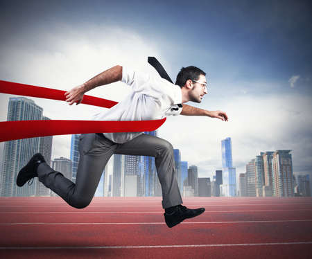 finishing line: Concept of successful businessman in a finishing line