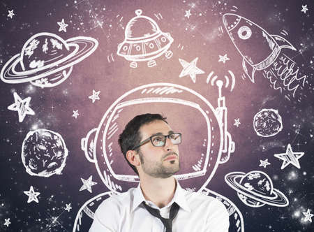 Concept of dreaming businessman with element of the space photo