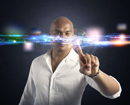futuristic man: Businessman working with a futuristic touch screen interface Stock Photo