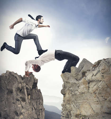 partnership power: Concept of teamwork and partnership with businessman like a bridge Stock Photo