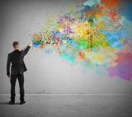 empresarial: Concepto de negocio con el empresario creativo y pintura en aerosol colores Foto de archivo
