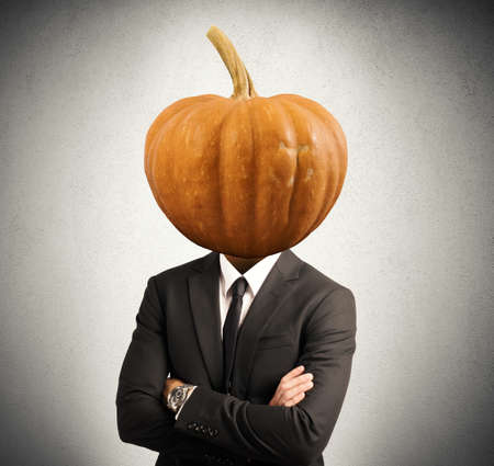 pumpkin head: Concept of stubborn businessman with pumpkin in head