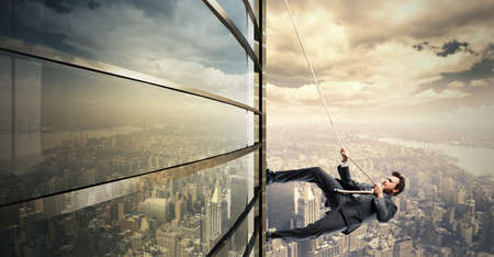 business challenge: Concept of Climb to the success with climbing businessman