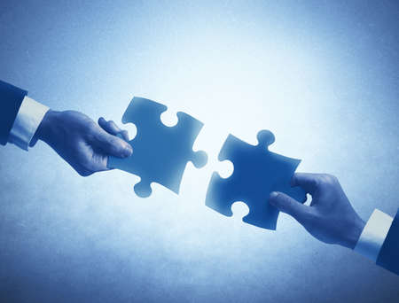 complete solution: Concept of business teamwork and integration with puzzle