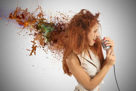 Concept of rock music with girl singer with motion effect photo