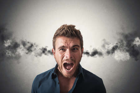 Concept of stressed businessman with smoke coming out of his ears photo