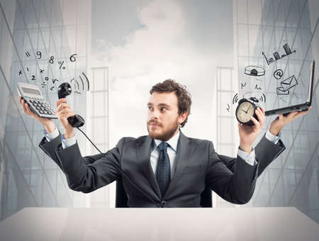 office chaos: Concept of busy multitasking businessman at work