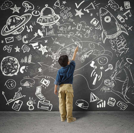 child drawing: Concept of small genius with kid and varius drawings Stock Photo
