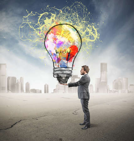 Businessman with creative business idea in hand photo
