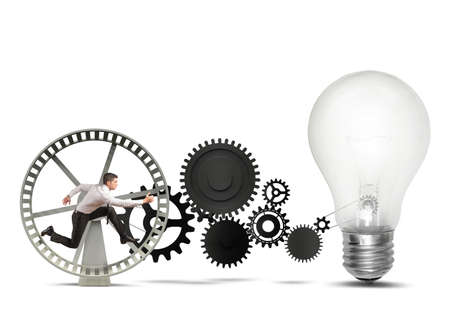 Businessman powering an idea with gear system photo