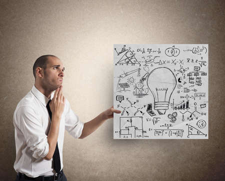 Businessman with Creative business idea on a paper sheet photo