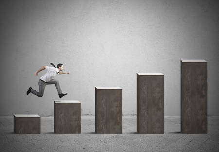 ascend: Businessman rises statistics. Concept of success and determination Stock Photo