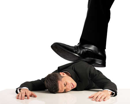 Concept of oppressed by the boss with businessman under a big shoe photo
