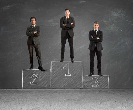 Concept of competition with businessman on podium photo