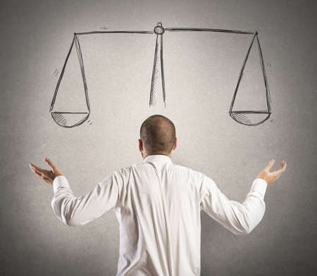 argumentation: Decision of a businessman with a drawing of balance