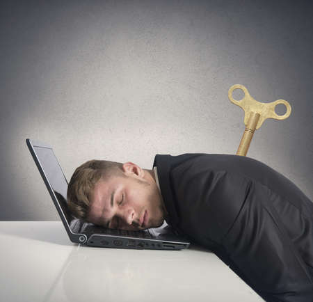 discharge: Discharge businessman that sleeps on a desk Stock Photo