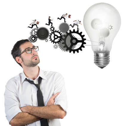 Businessman powering a big idea with a gear system