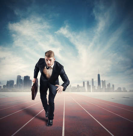 Business competition with running businessman in the racetrack photo