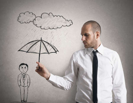 Concept of Assistance in business  with businessman with umbrella photo