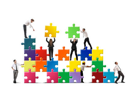 business collaboration: Team of businesspeople build a new company