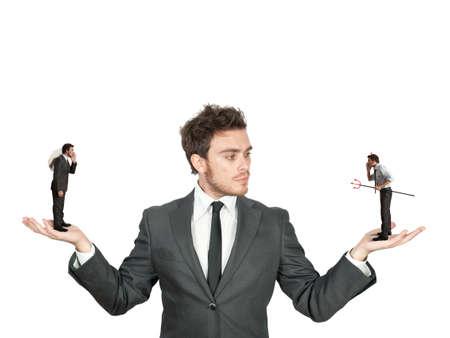 Uomo d'affari confuso tra l'essere buono o cattivo Archivio Fotografico - 25799215