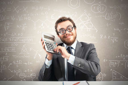 invoices: Concept of success with happy nerd businessman with calculator