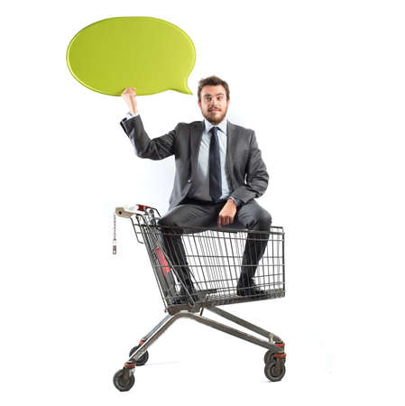 shopping carriage: Big message of a businessman with shopping cart