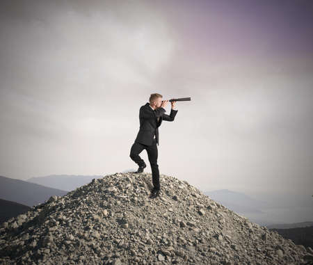 Concept of business vision with businessman with telescope photo