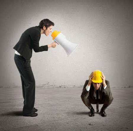 reproach: Concept of reproach with businessman shouting through a megaphone Stock Photo