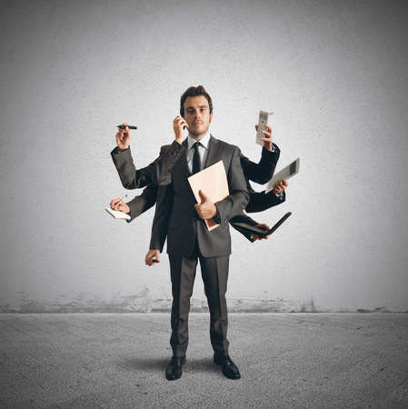 Concept of multitasking with businessman who carries out various operations photo