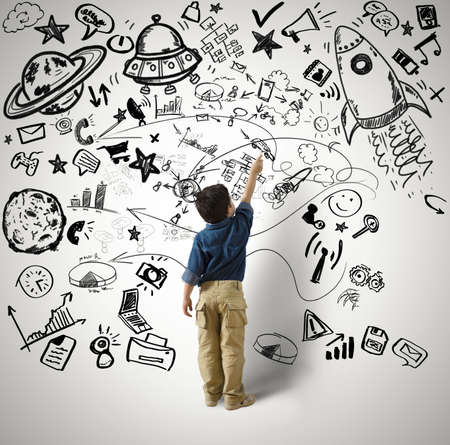 dream vision: Concept of small genius with kid and varius drawings Stock Photo