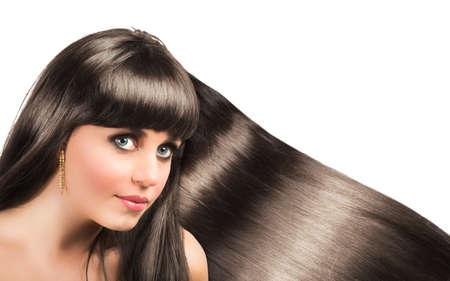 Long shiny hair of a beautiful brunette woman photo