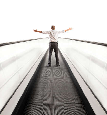 Concept of Easy way to success with businessman and escalator photo