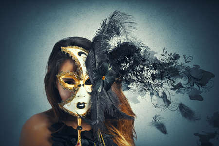 Beautiful woman in carnival mask with motion effect photo