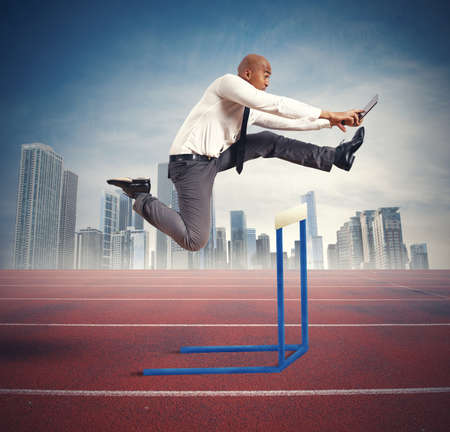 Concept of career difficulty with jumping businessman photo