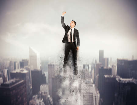 Concept of determination and success with flying  hero businessman photo