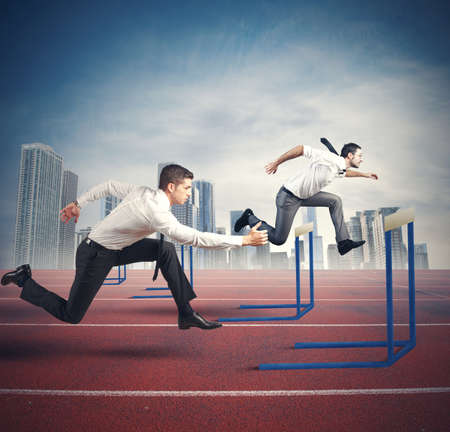 obstacle: Concept of business competition with jumping businessman