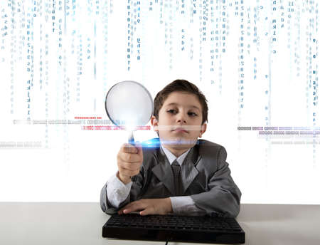 investigating: Young boy looking for malicious code of a virus Stock Photo