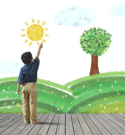 어린 아이는 벽에 녹색 파노라마를 그립니다