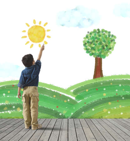 Young child draws a green panorama in a wall photo