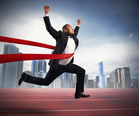 Success of a businessman in a finishing line photo