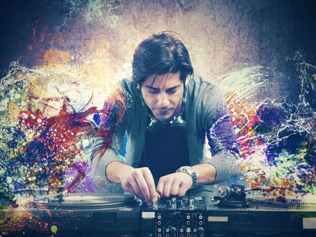 DJ at work playing music with a mixer photo