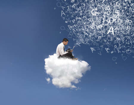 Internet and social network concept with businessman on a cloud photo