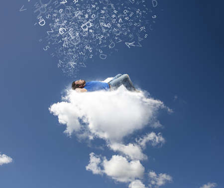 A boy relaxing on a soft cloud