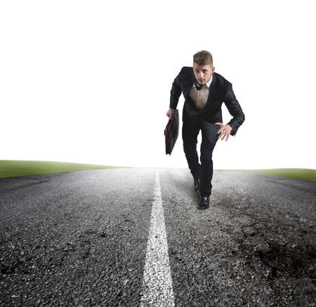 Business in action with running businessman in a road photo