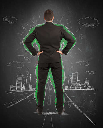 powerful man: Concept of power of a businessman with drawing of a muscles