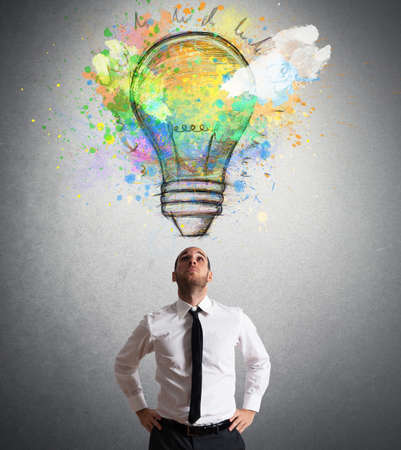 Businessman illuminated with a big creative idea