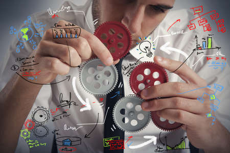 engineering tools: Concept of build a business system with gear Stock Photo